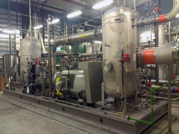 Gas scrubbing and compression plant.  Stainless steel passivized vessels and exchangers
